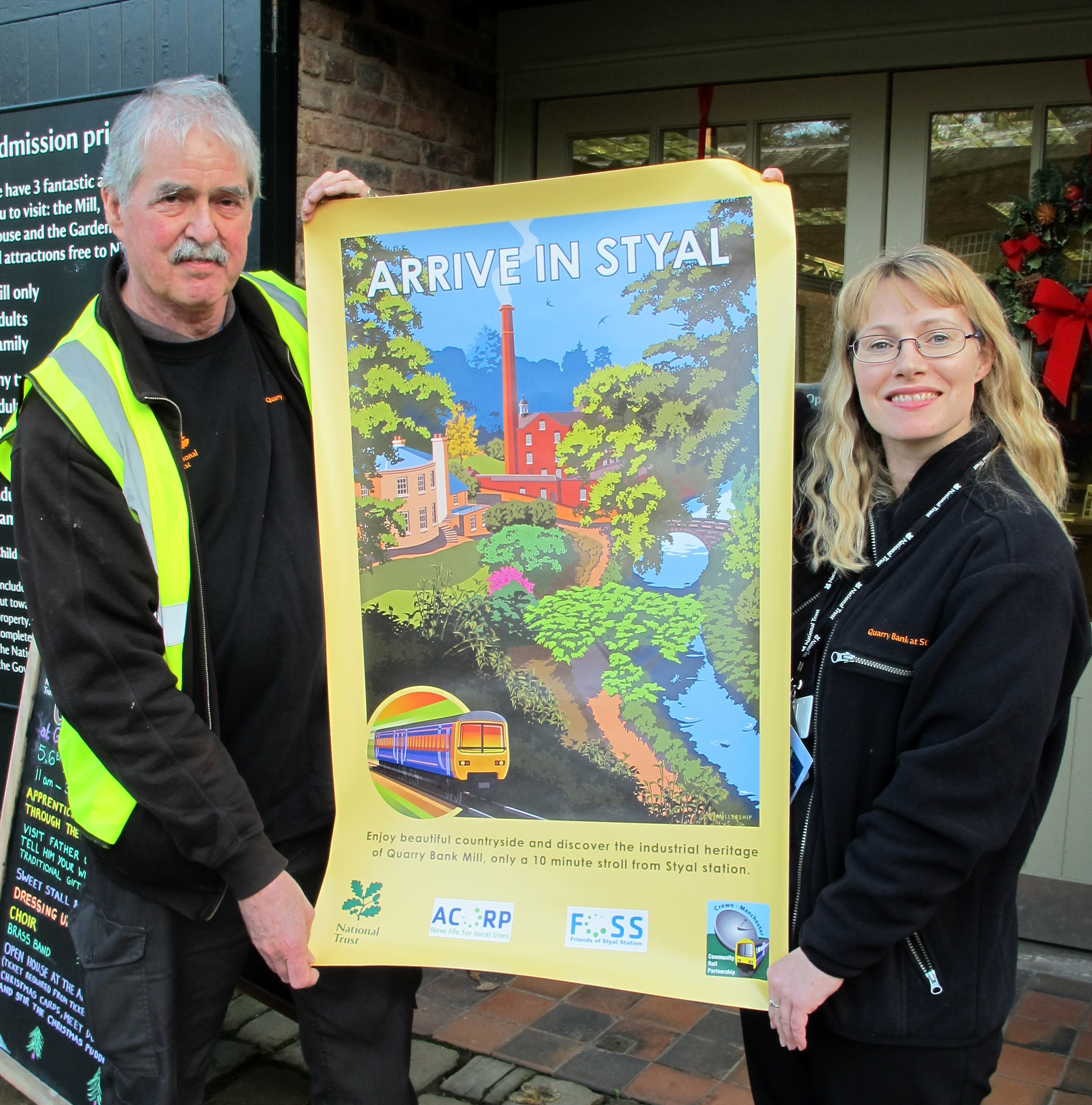National Trust staff show off the new posters.